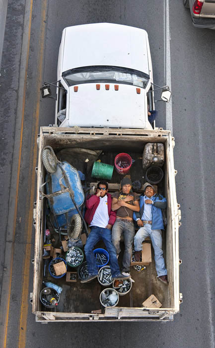 aerial birds eye view of people riding car pooling in back of pickup trucks from above alejandro cartagena 5 Riding in the Back of Pickup Trucks   A Birds Eye View