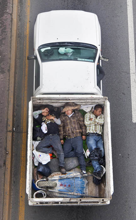 aerial birds eye view of people riding car pooling in back of pickup trucks from above alejandro cartagena 6 Riding in the Back of Pickup Trucks   A Birds Eye View