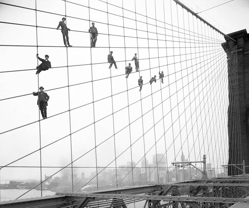 hanging out on brooklyn bridge cables black and white old vintage Picture of the Day: Hanging Out on the Brooklyn Bridge, 1914