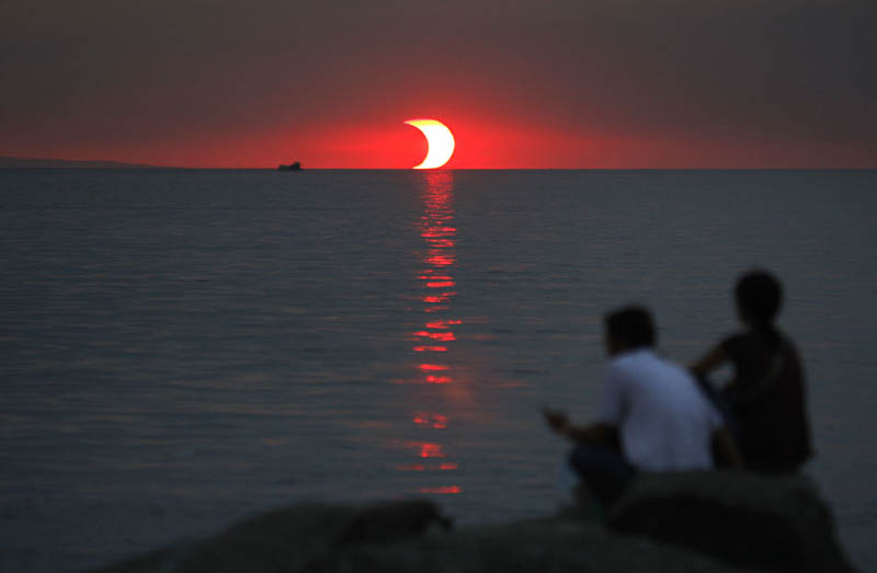 partial solar eclipse at sunset Picture of the Day: A Sunset Eclipse