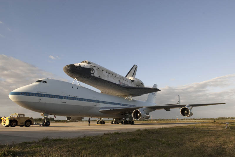 space shuttle discovery on top of another plane In Pictures: Space Shuttle Discoverys Final Flight [35 photos]