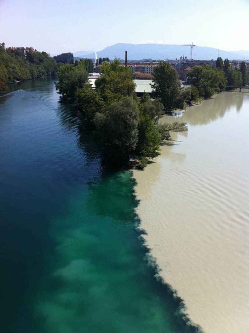 two rivers colliding geneva switzerland rhone and arve rivers 2 Bell Mouth Spillways: How Giant Holes in the Water are Possible