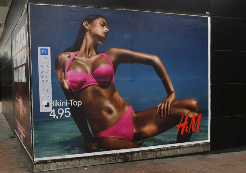 hm photoshop adbuster street art hamburg germany 2 Anonymous Street Artist Adds Photoshop Toolbar to H&M Billboards