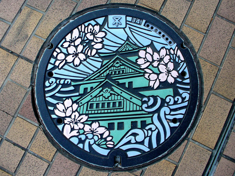 japanese manhole cover art Turning Transmission Towers into Giant People