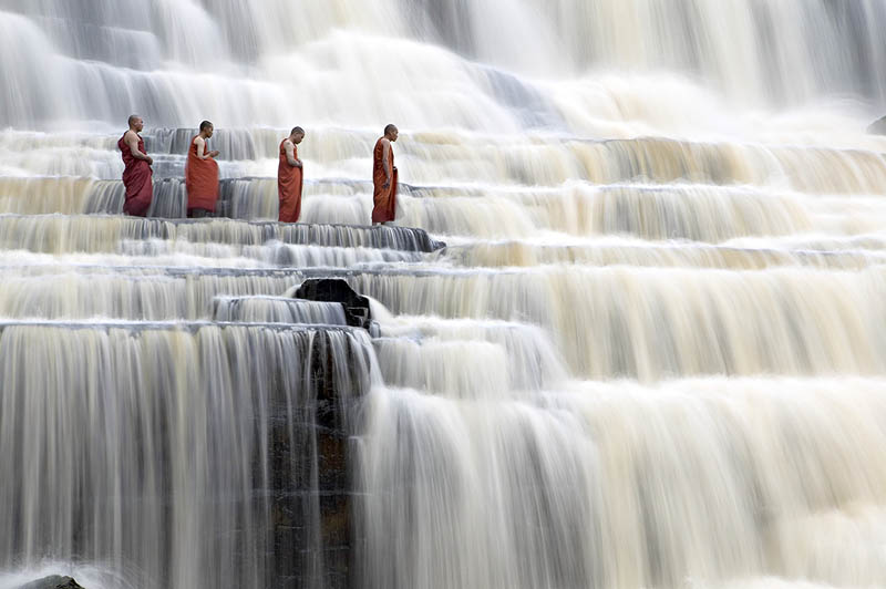 mediating monks on pongour falls vietnam Picture of the Day: Meditating Monks at Pongour Falls