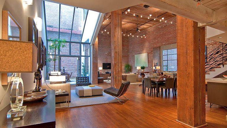 Stunning open concept loft with exposed brick twistedsifter for Open concept loft