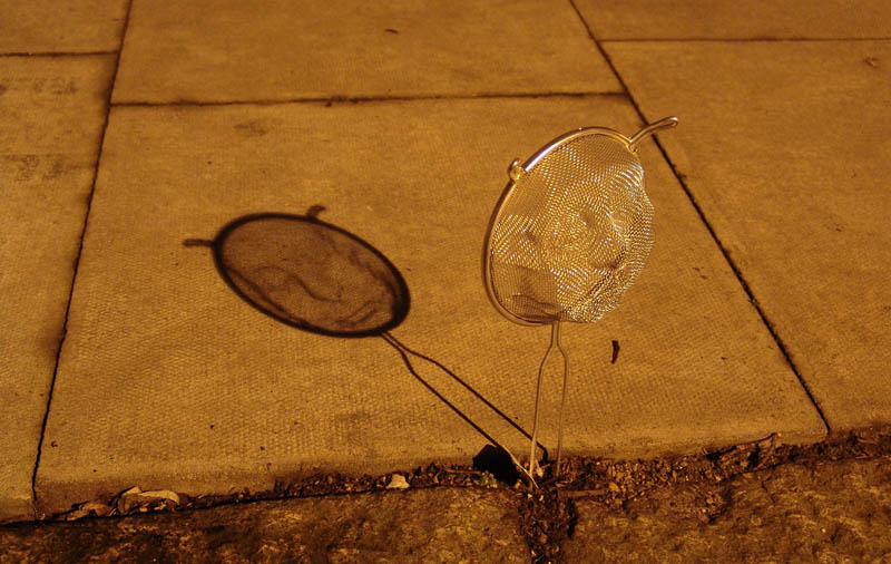 strainer shadow faces made from colanders isaac cordal 4 Faces Drawn Onto Maps by Ed Fairburn