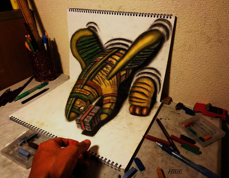3d drawing with color pencils and two sketchbooks perpendicular. artists hand visible for reference