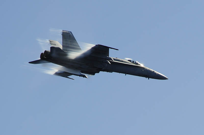 f18 hornet breaking sound barrier streaks of air show speed