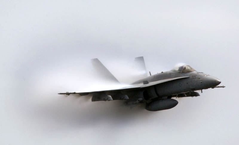 closeup shot of an airplane going supersonic