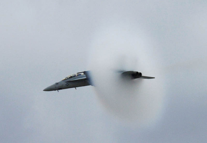 super hornet going supersonic speed from the side view