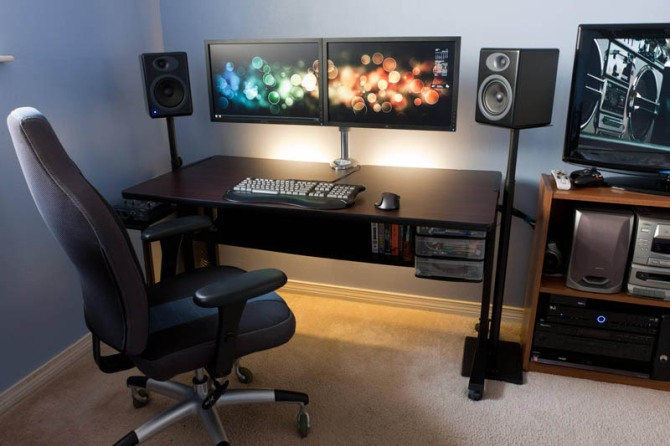 clean minimal computer station setup with standing speakers and dual monitors side by side