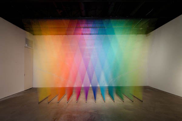 color spectrum made from different colored thread art installation
