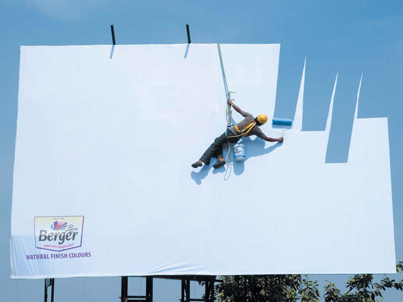 billboard with painter painting the sky