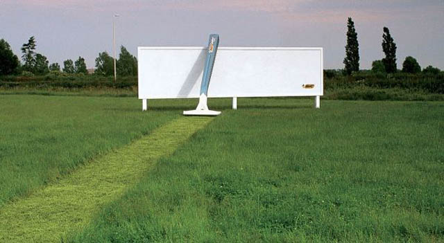 billboard for razors showing grass cut leading up to billboard and giant razor