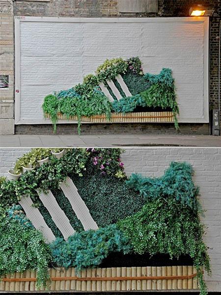 adidas billboard with plants growing on it