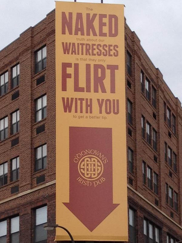 funny billboard says different message if you just read the words in big font but there is small print too