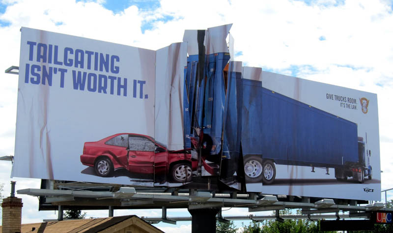 billboard against tailgating shows crumpled truck accident