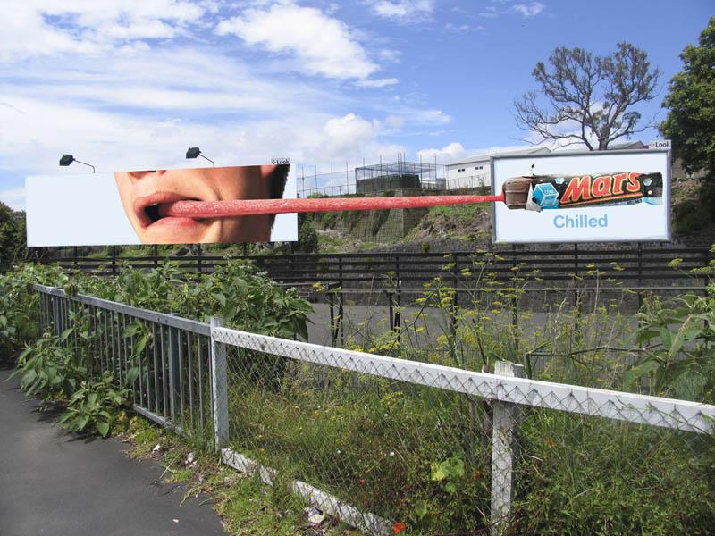 mars billboard tongue stuck to mars bar on a second billboard