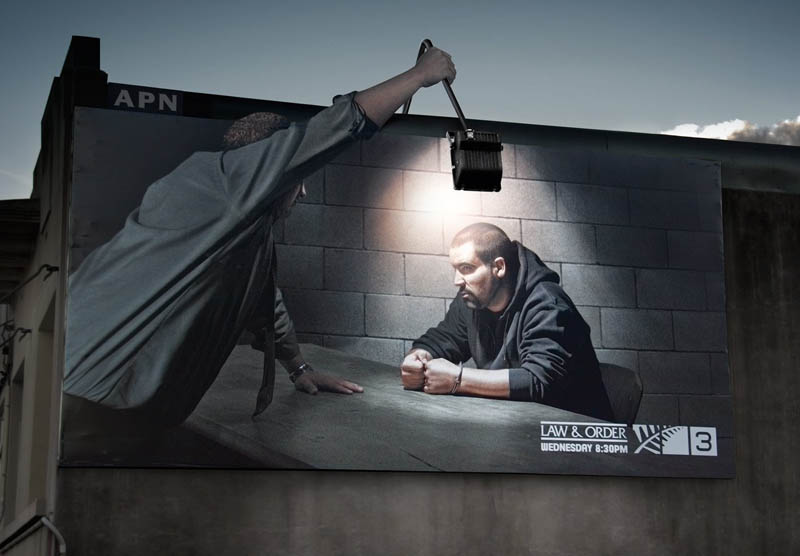 billboard shows interrogation using billboards own light
