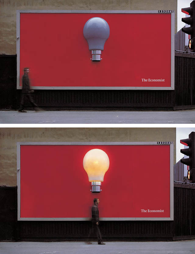 economist billboard with lightbulb that lights up when you walk past