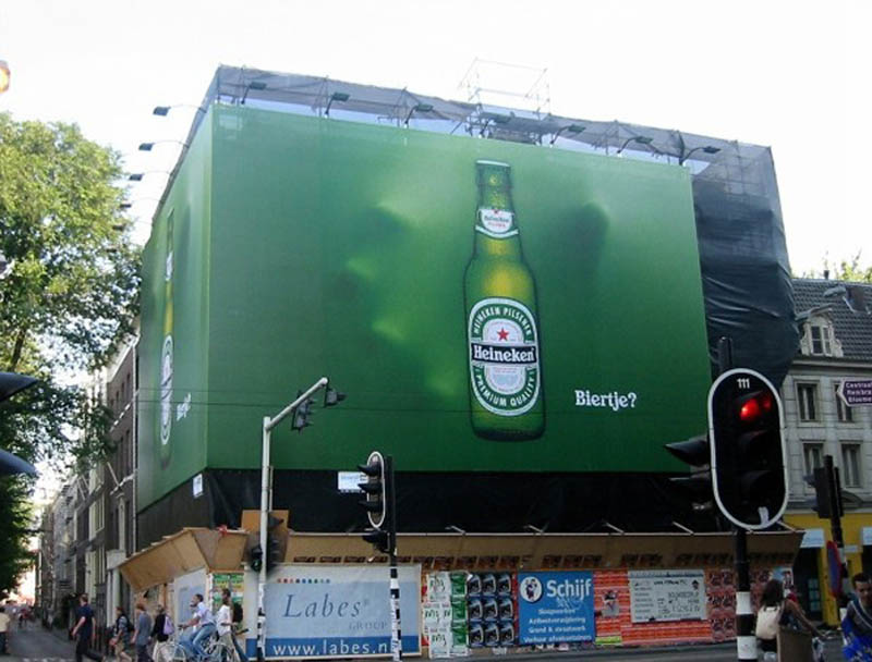 hand coming out of billboard to grab heineken bottle