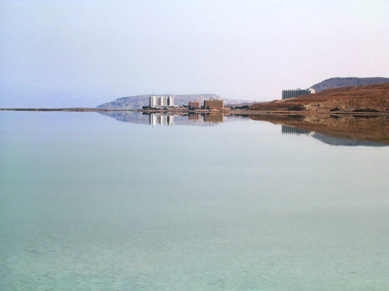 reflection of buildings on the shore of the dead sea