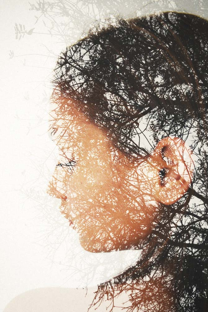 colored double exposure of woman with trees in background