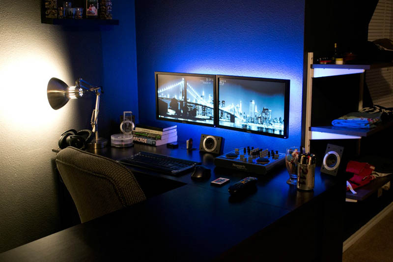 Dual Monitors Mounted Directly Onto The Wall With Backlit Blue Led Lights