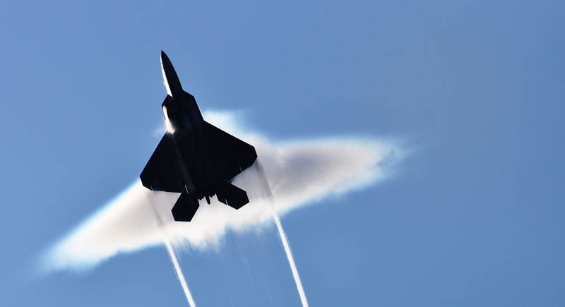 f22 raptor breaking the sound barrier from below