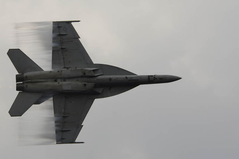 vapor trails from super hornet going supersonic