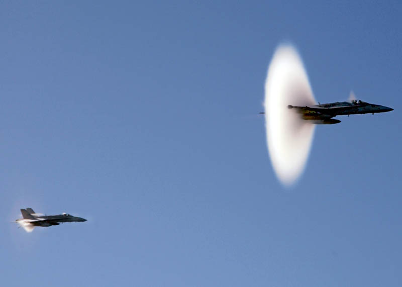 two planes breaking the sound barrier at mach 1 at the same time