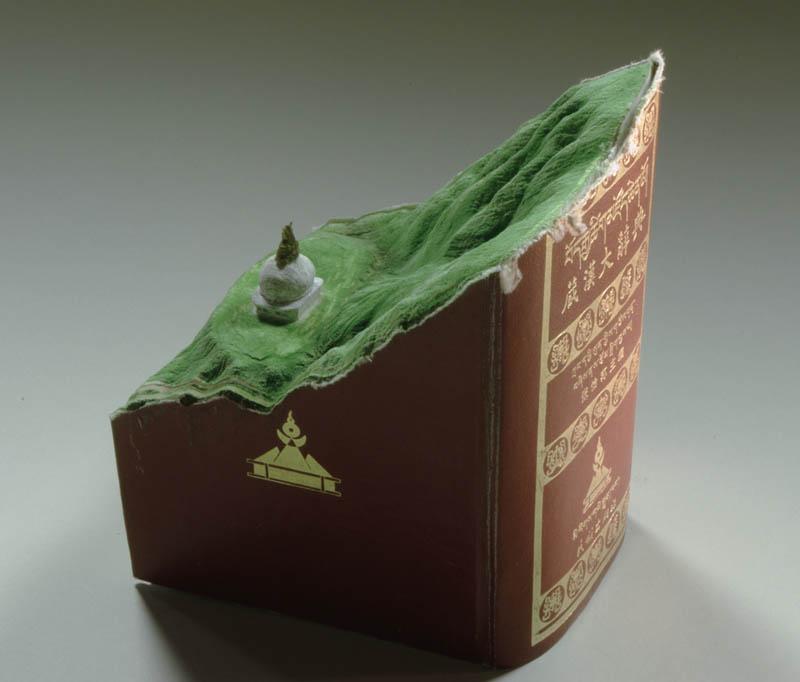landscape carved into large book