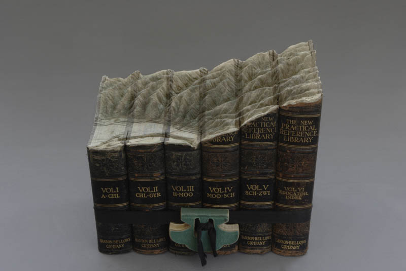 mountain region carved into top of six books