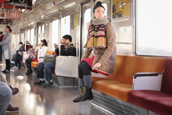 natsumi hayashi self portrait looks like she is levitating in subway car