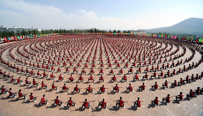 thousands of kung fu fighters arranged in concentric circles for heritage day demonstration
