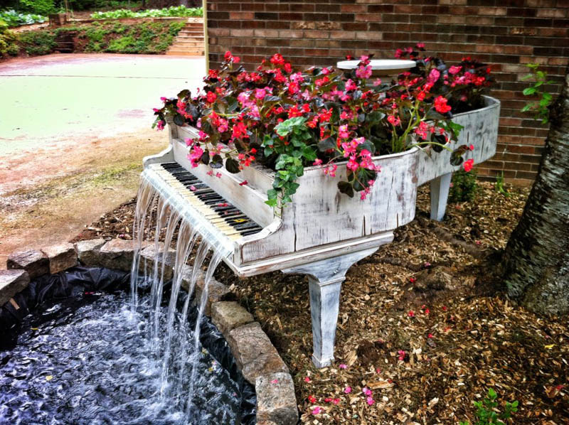 old piano turned into outdoor water fountain Mom Gives Son Lamp Filled With Items She Found Doing His Laundry Growing Up