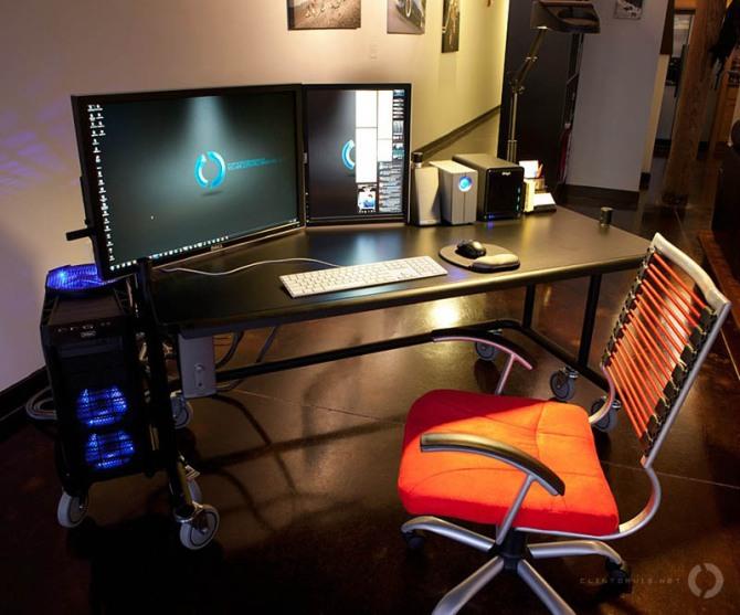 dual monitor setup one landscape one portrait clean desk space