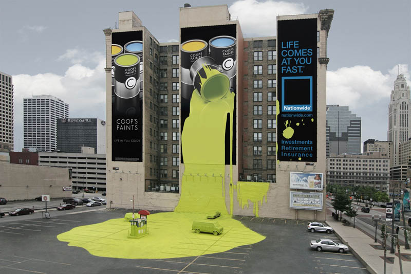 outdoor ad looks like giant bucket of paint spilled onto parking lot ground and made a mess