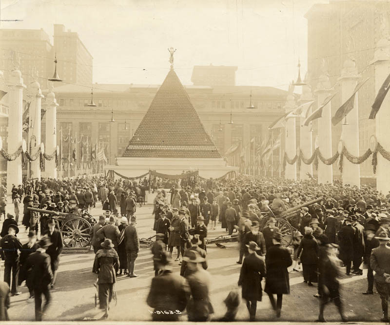 large pyramid of captured german helemts from world war I outside of grand central terminal in new york city 1918