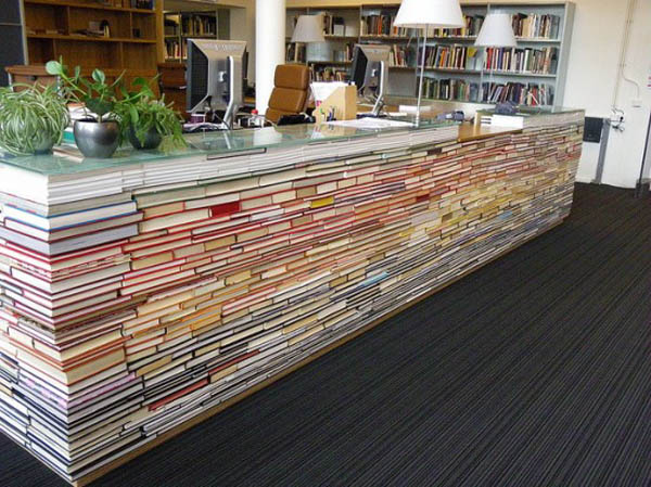 using lots of old books to create a desk & 50 Creative Ways to Repurpose Reuse and Upcycle Old Things ...