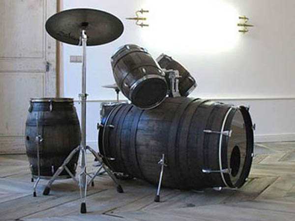 using old barrels to make a drum set