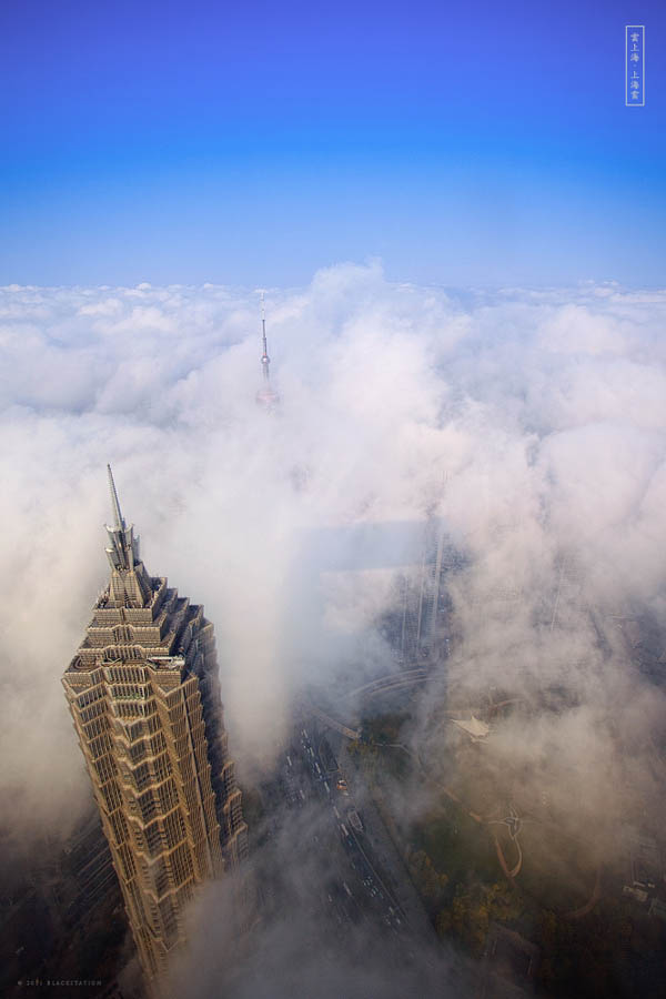 aerial view of shanghai above the clouds