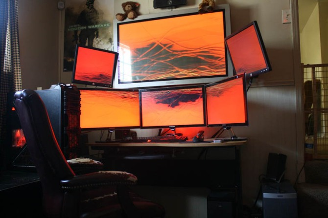 computer station setup with six monitors three on bottom three on top