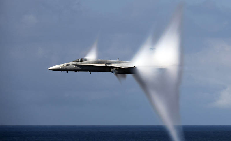 vapor trails from plane doing a low pass and breaking sound barrier