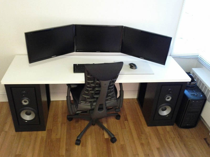 three monitor setup all landscape mounted to wall no cables showing