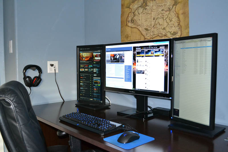 one large monitor in the middle flanked by two portrait style monitors on each side