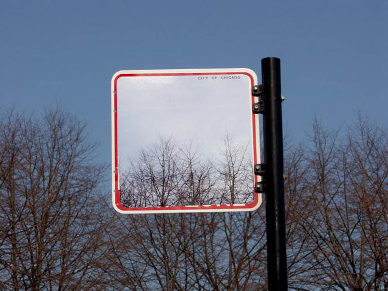 street sign that appears to be transparent but it not