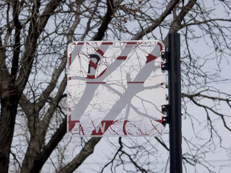 street sign looks transparent with trees behind it visible using stickers and printed photos