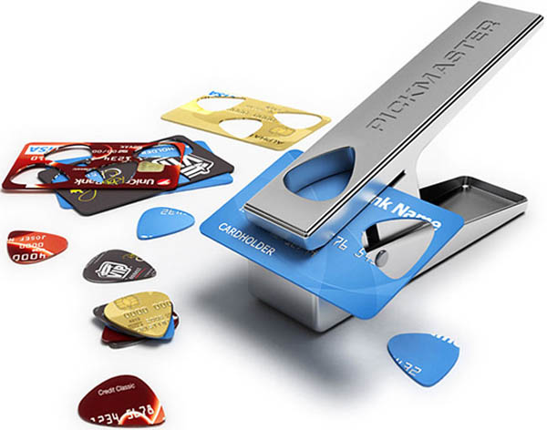 stamping old credit cards into guitar picks